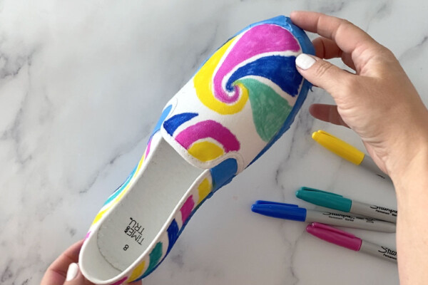Canvas shoe with swirl designs drawn on it