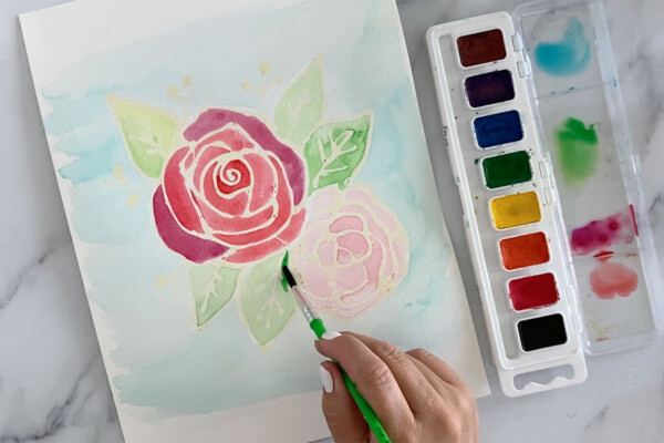 Hand painting flowers with watercolor paint