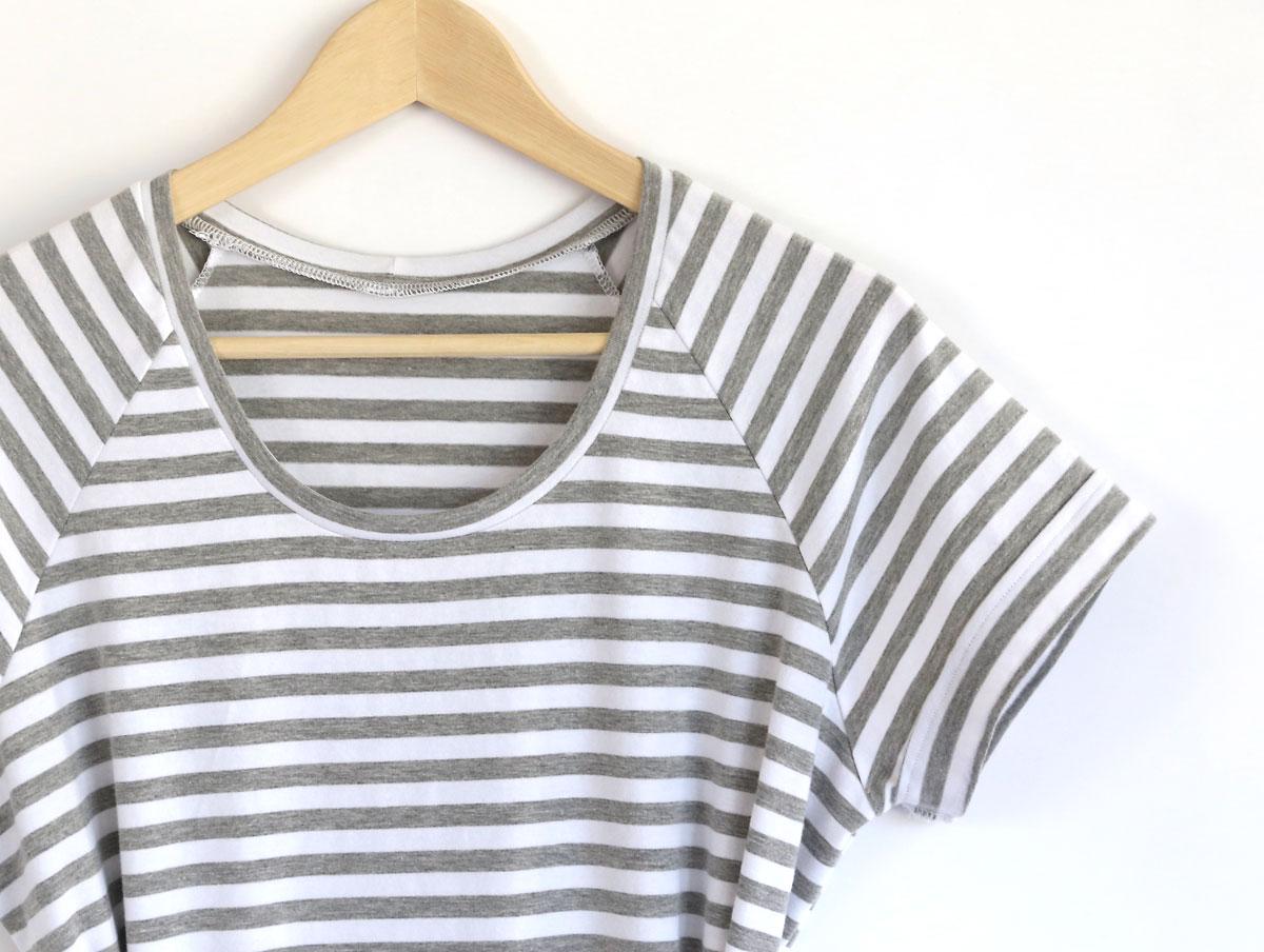 Closeup of neckline of t-shirt dress on a hanger