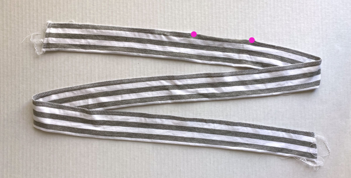 Tie piece folded in half lengthwise and sewn along raw edges, with 3 inch opening left