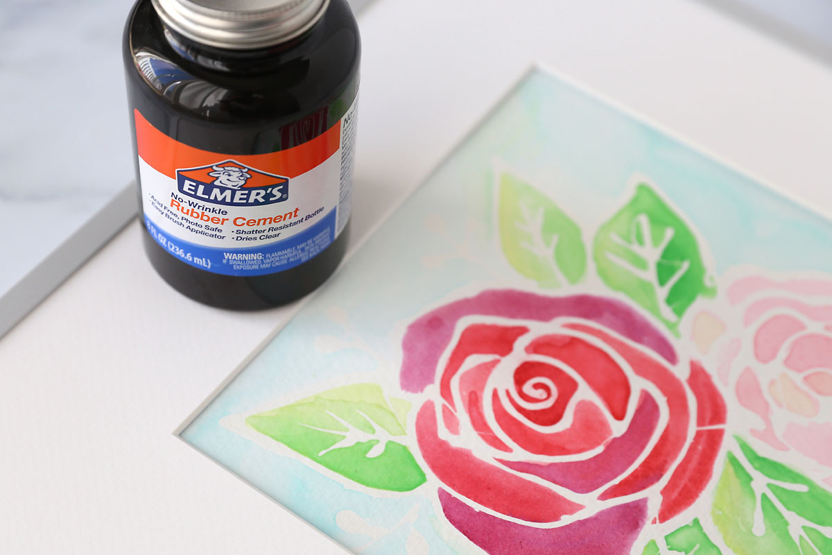 Flower painting and bottle of rubber cement