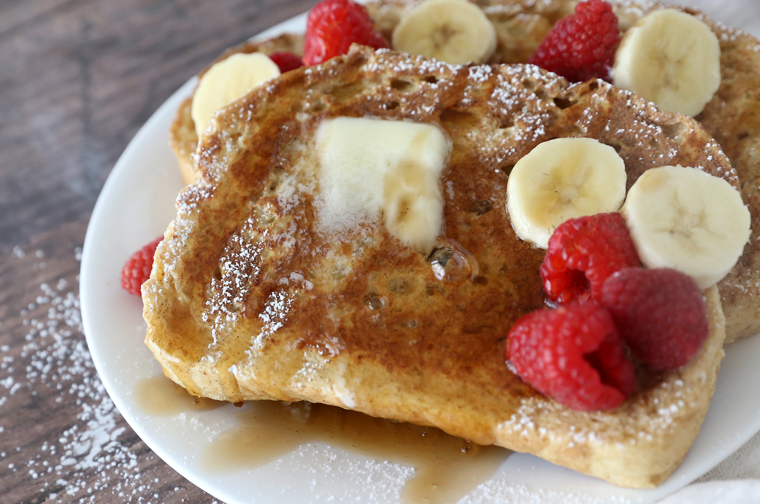 French toast with butter and syrup on a plate