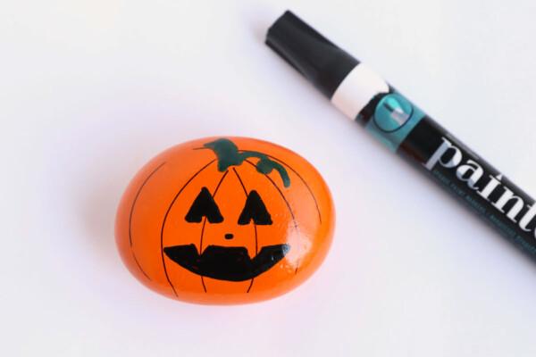 Pumpkin painted rock and paint pen