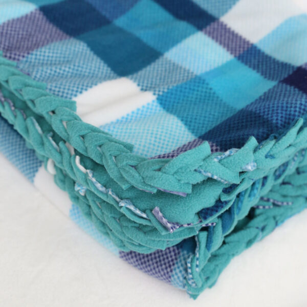 Folded fleece blanket with braided edge