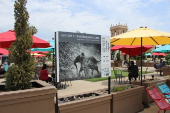 Signage in front of the San Diego Museum of Art for current black and white photography exhibition 'Genesis' by Brazilian photographer Sebastião Salgado at the Museum of Photographic Arts.