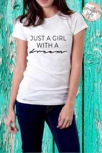 Just a Girl with a dream tee designed by It's a Southern Life Y'all. Available in white, pink, silver, heather grey, and heather blue.