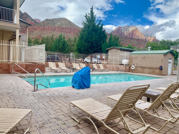 quality inn springdale zion national park swimming pool with red sandstone cliffs in background