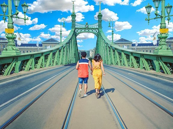 liberty bridge budapest hungary europe buda castle couple travel