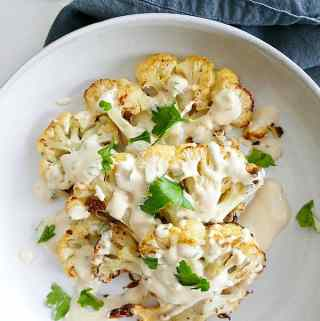 Cauliflower Steaks with Lemon Parsley Tahini