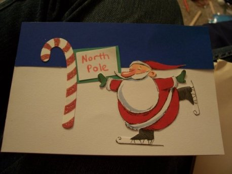 Santa skating next to a sign that says north pole on a Christmas card