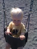 E on the swing at the park