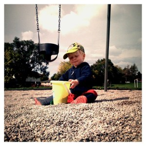 E playing in the pea gravel