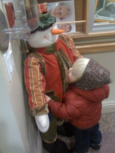 hugging the snowman at great-Gramma Sue's place