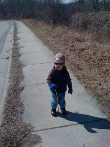 E in his hoodie, vest, and knit hat