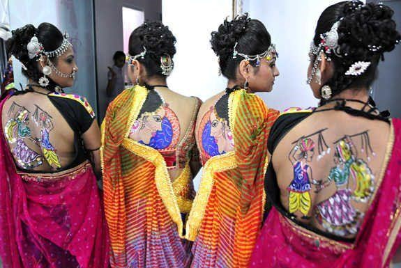 girls showing back for navratri tattoos