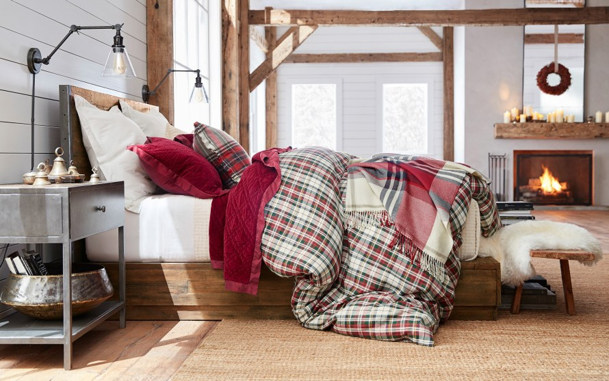Plaid duvet on bed