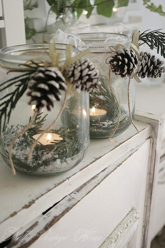 pine-cone candles in glass containers