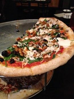 half devoured vegan pizza at Johnny Rad's