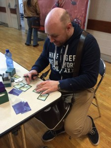 Julian defacing people's cards.
