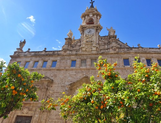 Church in Valencia with orange trees in the foreground