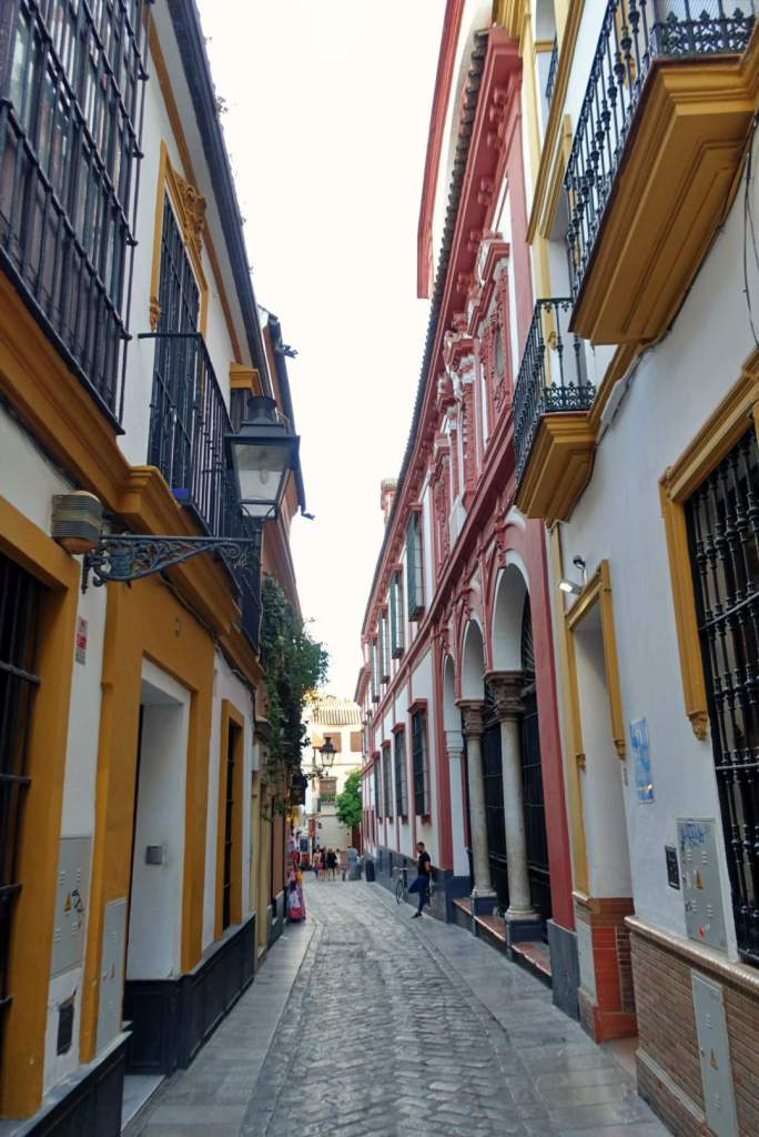 Colourful street in Santa Cruz, Seville