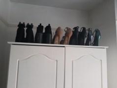 Heels organised on top of wardrobe