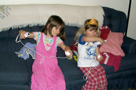 Abbye & Hannah dressed up & playing Wii Music before bed