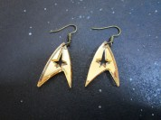 gold star trek insignia dangle earrings on space background