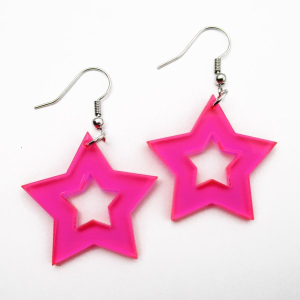 neon pink star earrings on white background