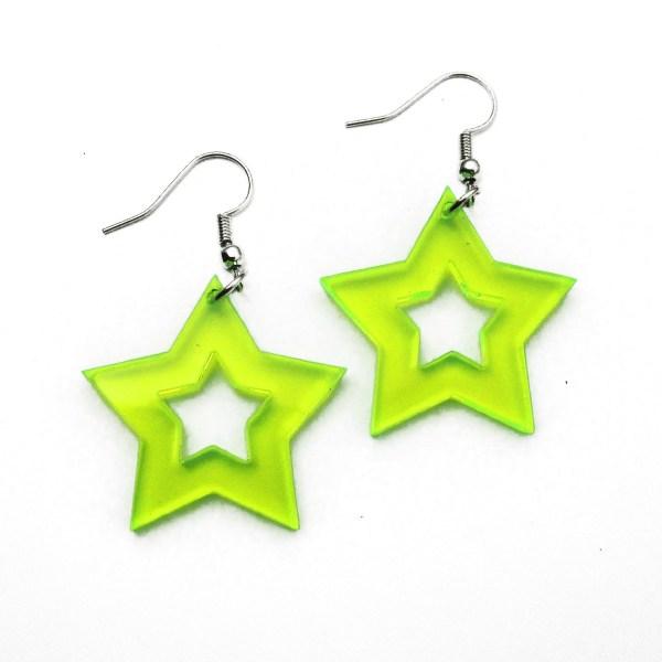 neon green star dangle earringson white background