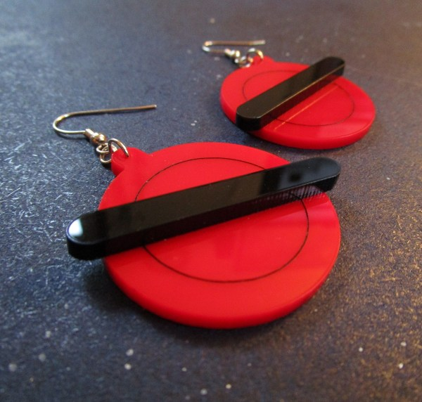 close up shot of 90s xmen jubilee cosplay earrings red and black
