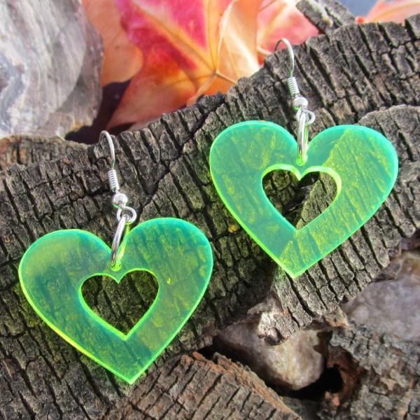 neon green heart silhouette 80s 90s rave earrings on wood