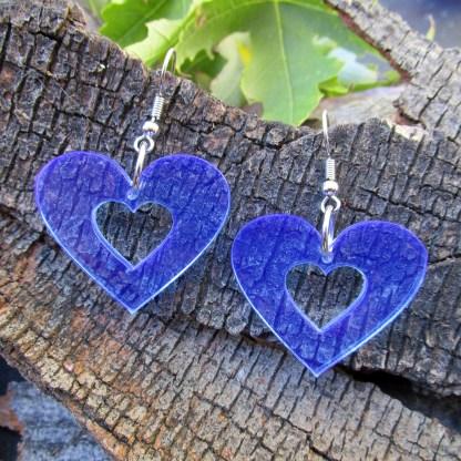 neon blue heart silhouette 80s 90s rave earrings on wood