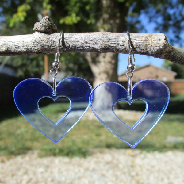 blue heart shaped dangle earrings hanging on stick to show transparency