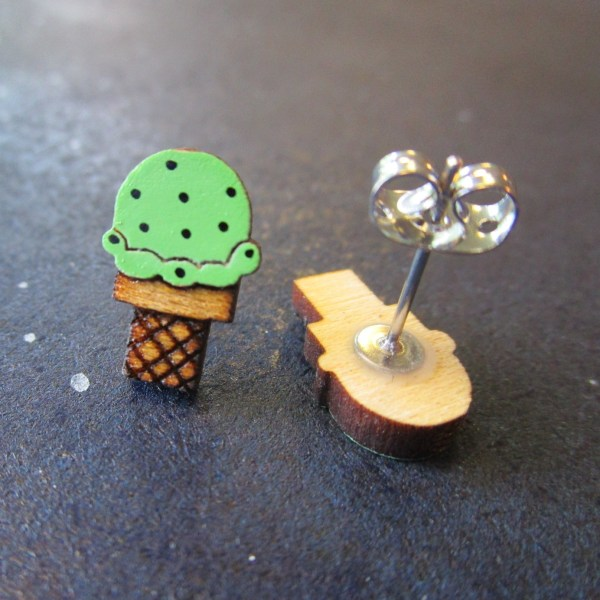close shot of Mint Chocolate Chip Ice Cream Earrings one facing forward ne upside down to show post and clutch back