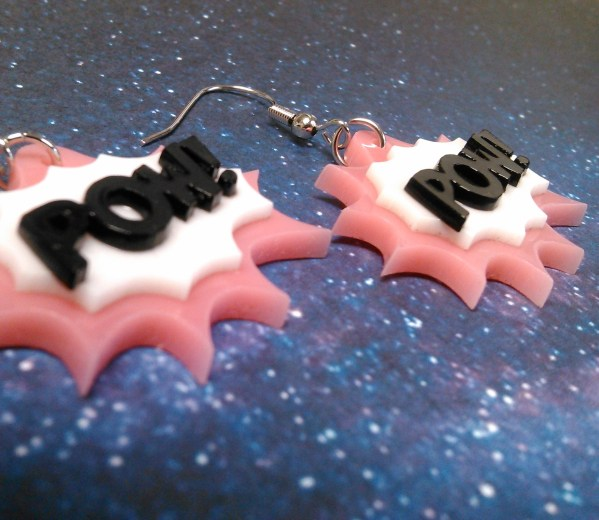 up close view of pink POW earrings