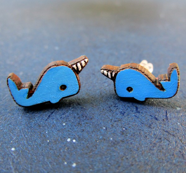 2 blue narwhal stud earrings close up