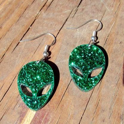 Shiny glitter Green Alien Earrings shining in sun
