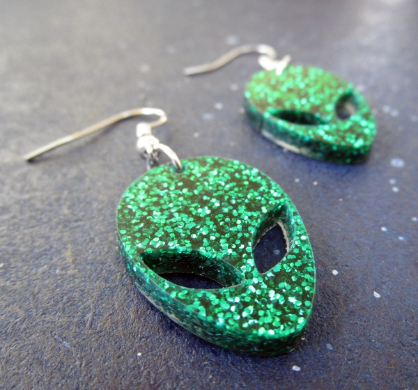 up close glitter Green Alien Earrings to show texture