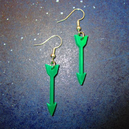 green arrow costume earrings on space background