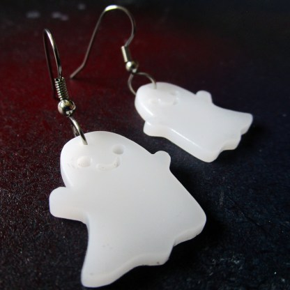 sideways close up of cute ghost earrings