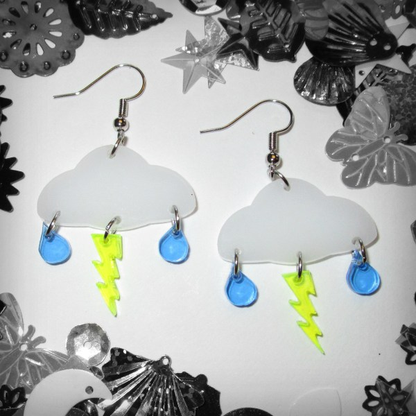 cloud bolt rain dangle earring set in color with black and white confetti background