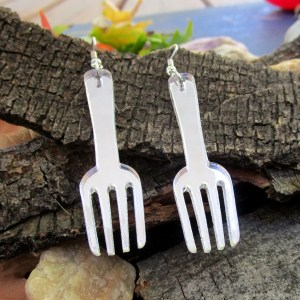 fork shaped pendant earrings on wood background