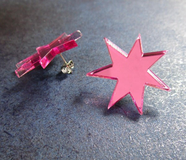 pink star jem earrings one facing front pne facing back to show stud post and clutchback