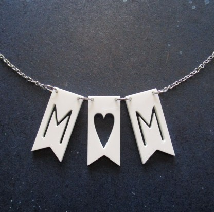 banner necklace with word mom cut out of flags