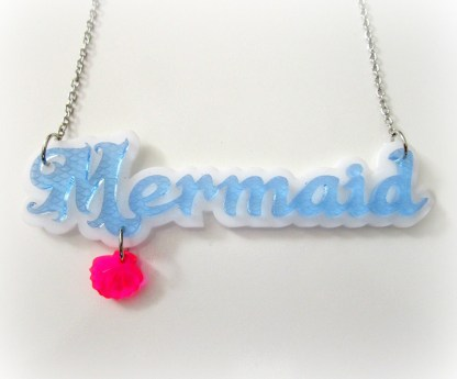 blue mermaid word pendant necklace with pink shell on white background