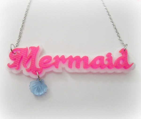 pink mermaid word pendant necklace with blue shell on white background