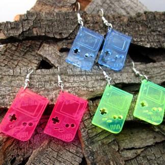 miniature handheld gameboy dangle earrings on wood background