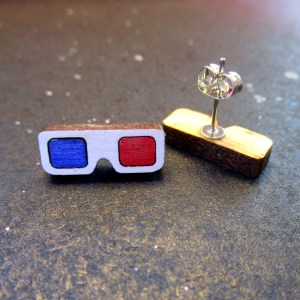 white retro 3d glasses stud earrings one facing forward one upside down so you can see the earring post with space background