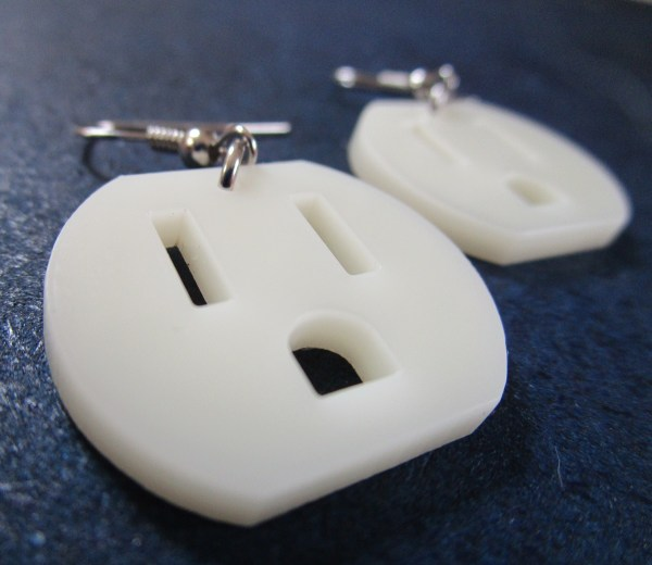 close up of electrical outlet face earrings to show detail